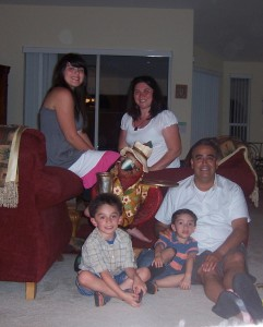 Velasco Family and 'Henry the Parrot' enjoying on of DJW's Gulf Coast properties.